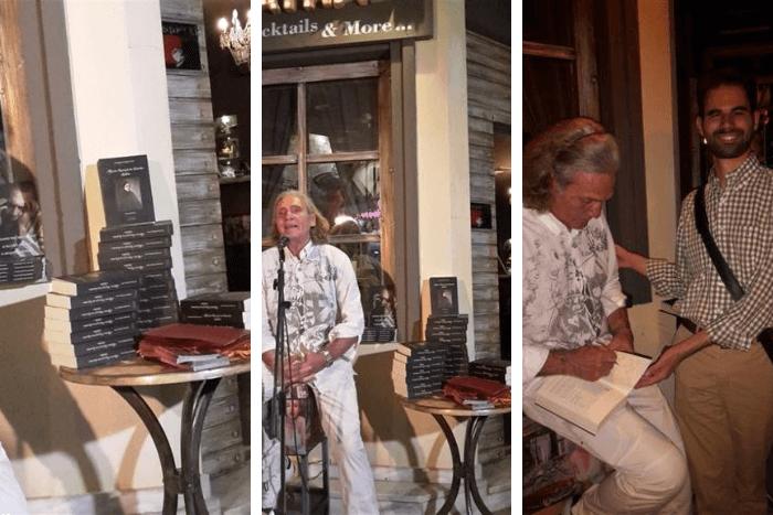 ο Αλπμέρτο εσκενάζυ μιλώντας για το βιβλίο και υπογράφοντας βιβλίο στον Βαγγέλη Αυγουλά