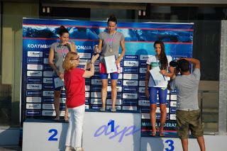 """Στην απονομή (πρώτη θέση) από το πανελλήνιο Πρωτάθλημα Ανδρών-Γυναικών 2015 καθώς και από το διεθνές μίτινγκ """"Ακρόπολις Grand Prix"""" 2013 αντίστοιχα (και τα δύο στο κολυμβητηριο του Αλίμου) ."""