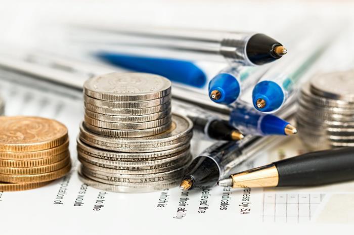 κέρματα και στυλό
