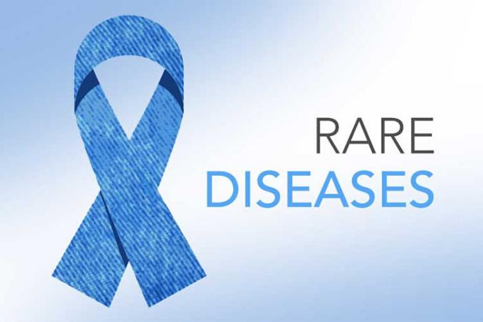 """η φράση """"rare diseases"""" και μπλε κορδέλα"""