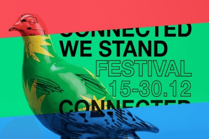 """ένα πουλί με τρία χρώματα κόκκινο, πράσινο, μπλε και η φράση """"Connected We Stand Festival 15-30.12.20"""""""