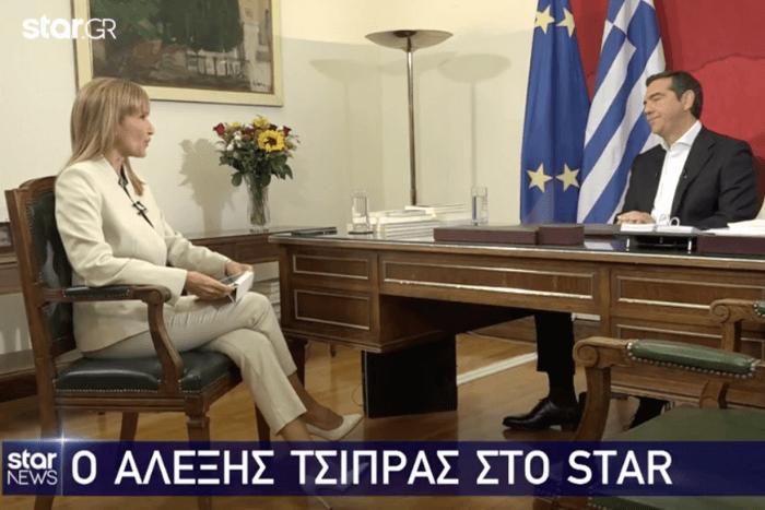 Η Μάρα Ζαχαρέα με τον Αλέξη Τσίπρα, στιγμιότυπο από τη συνέντευξη. Πάνω αριστερά λογότυπο του τηλεοπτικού Σταθμού STAR